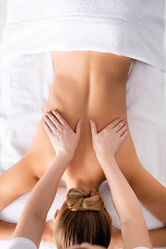 Therapist massaging back